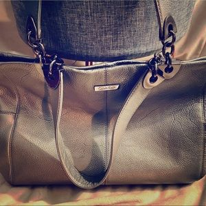 Calvin Klein Silver tote... has barely been used.
